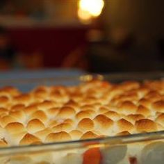 Candied Yams with Marshmallows: Canned or peeled yams, 1/4c butter, 1/4-1/2c brown sugar, dash of cinnamon, mini marshmallows. 400 degrees for 20 minutes; longer for peeled yams. Add marshmallows on top 5-10 minutes before 'doneness.'