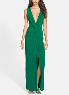 Ooh la la! Absolutely love this emerald twist front jersey gown.