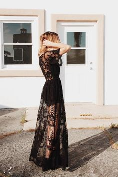 Channel your inner Coachella goddess in this chic black lace maxi dress! With a plunging neckline and semi-sheer skirt for an effortless bohemian look.
