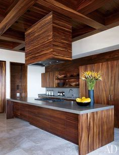 At George Clooney's Mexican villa—which is part of a Legorreta + Legorreta-designed compound he shares with Cindy Crawford and Rande Gerber—the Henrybuilt kitchen is appointed with a Viking cooktop and cabinetry faced in parota wood. Cindy Crawford, Architectural Digest, Celebrity Kitchens, Celebrity Houses, George Clooney House, Kitchen Interior, Kitchen Decor, George's Kitchen, Timber Kitchen