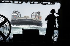 ATLANTIC OCEAN (Aug. 4, 2014) Landing Craft Air Cushion (LCAC) 4 conducts amphibious mobile warfare training with the amphibious assault ship USS Iwo Jima (LHD 7). Iwo Jima is underway conducting amphibious integration training. (U. S. Navy photo by Mass Communication Specialist Seaman Apprentice Shelby M. Tucker/Released)
