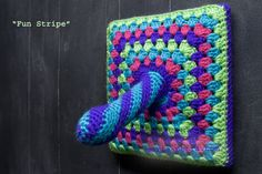 Fun Stripe: A Mounted & Crocheted Dildo/Granny Square by (maría)petra fortes-schramm