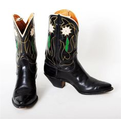Vintage cowboy boots womens black Justin are darling! Fancy uppers have white, green and red inlaid flowers and leaves, yellow stitching and white piping. $495 luckystargallery.com