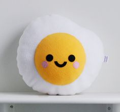 "This oversized <a href=""https://www.etsy.com/listing/223251499/fried-egg-cushion-food-cute-pillow"" target=""_blank"">egg</a>."