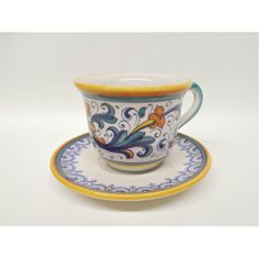 Dating back to the sixteenth century, the Ricco design is heavily influenced by the frescoes of Renaissance artist Pietro Perugino.  He was the mentor of Raphael, and their work inspired the patterns of Deruta ceramics that date back to the sixteenth century. This ceramic pottery cup was handcrafted and painted by the artists in the classical Italian pottery fashion in traditional Renaissance colors.
