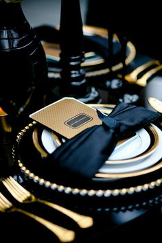It's a black tie affair, Black, Gold and White wedding reception table place setting or tablescape. Very elegant. Follow Us: www.jevelweddingplanning.com www.facebook.com/jevelweddingplanning/www.pinterest.com/jevelwedding/ www.twitter.com/jevelwedding/