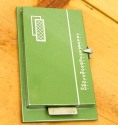 Flip up address book.  The dial on the right moves to the letter you want.  Press at the bottom and it opened.  Mom had one for years.