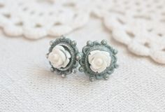 Shabby chic blue and cream rose earrings.  Post style.. $14.00, via Etsy.