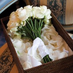 Looking for the ultimate elegant bridal bouquet? Plush white roses will never go out of style. (At @Mandy Bryant Dewey Seasons Hotel George V Paris)