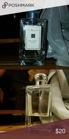 Jo Malone London English Pear and Freesia Cologne Jo Malone London English Pear & Freesia Cologne originally purchased from Saks Fifth Avenue. This bottle is 1/4 full. English Pear & Freesia, a fragrance that captures the luscious scent of just ripe pears, cooled by the autumn air and ready to twist free from the tree. Inspired by a walk in an orchard,  secluded within a walled garden. Jo Malone London  Other