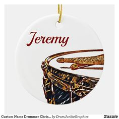Customize this cool drumming Christmas ornament with the name of your favorite drummer. What a unique gift idea for percussionists and drum enthusiasts! Check out www.drumjunkiegraphics.com for more great drummer merch and musician gifts - all designed by a drummer! #drummerchristmas #rockandrollchristmas #customdrum #marchingband #snaredrum #drumjunkie