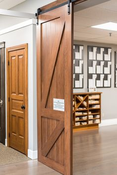 large wood stained barn door with black hardware Custom Interior Doors, Barn Doors, Contemporary, Modern, Hardware, Building, Wood, Furniture, Black