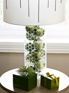 I officially want an army of open base lamps.    Put Home Accents to Work Got a pretty lamp with an open base? Fill it with ornaments. A kitchen bowl could do the same work in a small space.
