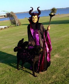 "Malificent robe from an '80's Butterick coat pattern with sleeve and collar alteration. Horn headpiece self designed from wet suit fabric and stitch detail.  Diablo had ""Angel"" wings enhanced with..."