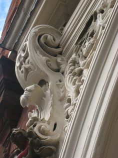 https://flic.kr/p/aeKxpX | The Corn Exchange, Rochester, Kent (1706) | Lower section of a carved end console bracket supporting a pediment and enclosing a carved spandrel, located above the main door to the Corn Exchange built in 1706 by Sir Cloudesley Shovell, M.P. for Rochester.