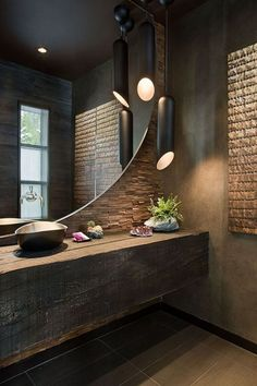 Look at this wooden bathroom counter and huge mirror wall with attached faucet!  Unique, innovative interiors!