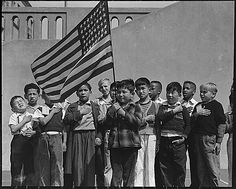 'Original Caption: San Francisco, California. Flag of allegiance pledge at Raphael Weill Public School, Geary and Buchanan Streets. Children in families of Japanese ancestry were evacuated with their parents and will be housed for the duration in War Relocation Authority centers where facilities will be provided for them to continue their education.' Central Photographic File of the War Relocation Authority, compiled 1942-45. (National Archives)