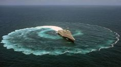 The littoral combat ship USS Independence (LCS 2) demonstrates its maneuvering capabilities in the Pacific Ocean off the coast of San Diego.  The littoral combat ship (LCS) is a class of relatively small surface vessels intended for operations in the littoral zone (close to shore) by the United States Navy.