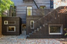 Architizer is the largest database for architecture and sourcing building products. Home of the A+Awards - the global awards program for today's best architects. Exterior Stairs, Exterior Cladding, Charred Wood, Arched Doors, Best Architects, Fire Escape, Through The Window, House Extensions, Outdoor Fire