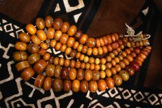 Amber beads on mud cloth