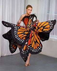 The Monarch Butterfly Dress by Luly Yang. I would wear the dress... but nix the feathers.