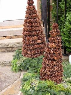 """I imagine there is a tomato cage under there with a few extra rings of wire attached to hold those pinecones. I would use a combo of wire and hot glue to hold each of the pinecones in place. A somewhat time consuming craft but worth it- just look at it! Omit the tomato cage and use a craft cone and 'm sure you could do this on a much smaller scale for inside. Wrap some lights around it or even add """"snow"""" (some white and silver glitter) to the tips and you have GORGEOUSNESS! -kelly"""
