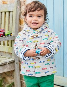 Never mind the grey clouds, this car-printed duffle coat has your little one covered. Extra poppers and shower-resistant fabric keep the wind and rain out, while a soft jersey lining (that's striped to boot) keeps the cosiness well and truly in.