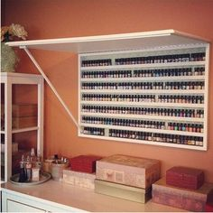 idea for storing nail polish- could cover front w/corkboard or mirror