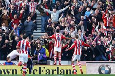 Peter Odemwingie celebrating his goal with the Stoke fans. >Final score: Stoke City 1-0 Hull City