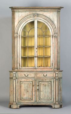 Pennsylvania painted pine 2-part corner cupboard, ca. 1800, retaining an old blue and ivory scrubbed surface, 100.25 h. x 52.5 w.