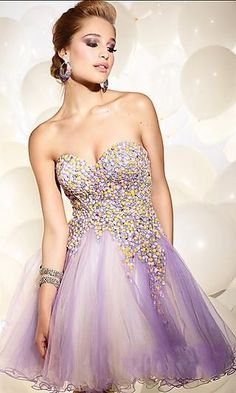 One of the most gorgeous dresses ever; such a beautiful flow of colors and embellishments. I love it! (: