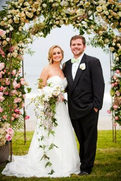 Florabundance Inspirational Design Days 2013 - The Bride and Groom stand in front of the Ombre styled Wedding Chuppah. Flowers include Phalaenopsis Orchids, Garden Roses, Jasmine Vines and Hydrangea.
