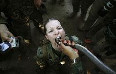 "A U.S. marine drinks the blood of a cobra during a jungle survival exercise with the Thai Navy as part of the ""Cobra Gold 2013"" joint military exercise, at a military base in Chon Buri province, Thailand, on February 20, 2013. About 13,000 soldiers from seven countries, Thailand, U.S., Singapore, Indonesia, Japan, South Korea and Malaysia participated in the 11-day military exercise"