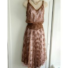 """VGUC Rebecca Taylor delicate brown/pink lace dress This is one of the most feminine dresses I've seen. It has an ethereal quality to it. I don't even think the modern Rebecca Taylor designs make 'em like this anymore. Features a pink slip dress with separate sheer lace overlay tank dress. Billowy fit up top on outer layer, so that top portion appears longer off the body. Measures: slip dress: bust: 16.5"""", length: 45""""; Outer lace: bust: up to 18.5"""", waist: expands to 15.25"""", length: approx…"""