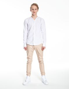 Model is wearing: white no-collar shirt & beige Universum pants made of eco-leather Leather Fashion, Leather Men, Leather Pants, Collar Shirts, Khaki Pants, Beige, Model, How To Wear, Color