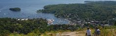 Hike to the top of Mount Battie in Camden Hills State Park and take in great views of three harbors