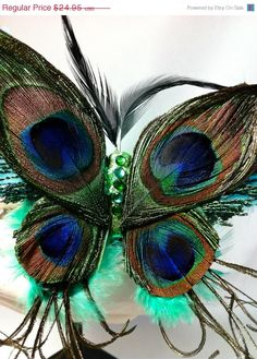 Peacock Butterfly Hair clip to match her crazy eye makeup!