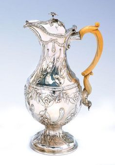 A George III silver covered hot water jug, Andrew Fogelberg, London 1771, 832gms. Height 29.7 cm . Provenance: Sotheby's Melbourne 22 April, 1985 - http://www.carters.com.au/index.cfm/item/106404-a-george-iii-silver-covered-hot-water-jug-andrew-fogelberg-londo/