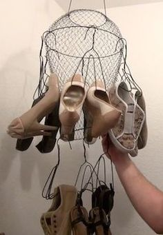 Use a $5 fish basket and some wire coat hangers to create a shoe chandelier.
