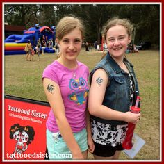Happy friends with matching dragon airbrush tattoos