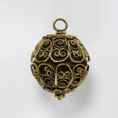 A parcel-gilt silver pomander, made in Italy in the 16th century; features a niello inscription  Pomander, gold filigree, enclosing a ball of ambergris.1600-1700  Gold and Silver Pomander, 16th Century