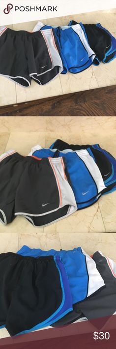 Three multi color Nike dry-fit shorts XS good cond Multi color dri- fit x-small Nike women's nylon shorts with elastic waist. Holes for pull strung if desired. Interior shorts with key pocket. Nylon. Comfortable. Two in excellent condition and one in good condition. Nike Shorts