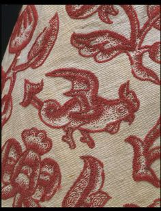 Jacobean Jacket detail (click through to image of full garment) from England 1630s Crewel work on cotton and linen twill ground; stem stitch with long, short and coral stitches and French knots