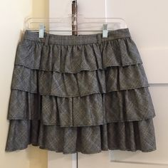 Skirt A cute ruffle grey and black plaid ruffle skirt that is great for work or a night out with girlfriend or on a date! True to size and in mint condition! J. Crew Skirts Mini