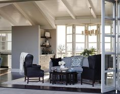 A Soft Blue-Gray Living Room  Larette designed this contemporary California farmhouse with a blue-gray living room that opens up to the outside. The soft color works with the bright natural light.
