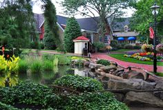 Take a stroll through the gardens at @peddlersvillage. This 18th century-inspired shopping village features landscaped gardens throughout the 42-acre property, including a traditional Dutch style tulip garden the brings the entire village to life when it blooms in spring.