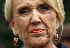 Republican Arizona Gov. Jan Brewer...one mean, rude, classless, stupid butthead.  She isn't just mean, she's completely insane.