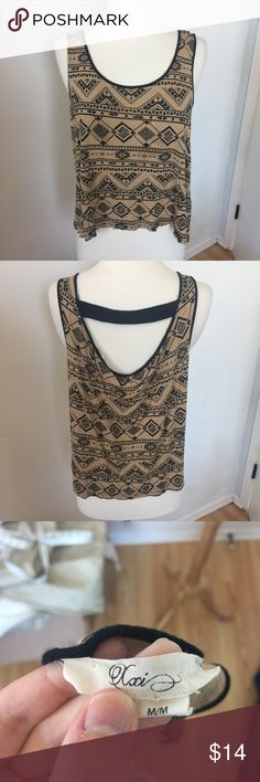 Forever 21 Brown Tribal Tank A69 Cute tank from Forever 21, brown with black patterns and a cutout with strap on the back. No flaws. Size medium. Forever 21 Tops Tank Tops