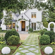 Exquisite lattice patterned landscaped walkway to charming white Tudor home - TMD Landscape Design. Charming inspiration if you love white painted house exteriors! #whitehouses #housedesign #exteriors #Tudor #landscapedesign #curbappeal White Exterior Paint, White Exterior Houses, Exterior Paint Colors, White Houses, Exterior Design, Home Design, Nachhaltiges Design, Design Blog, Tudor House