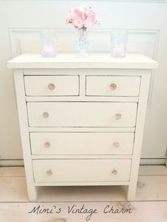 Old white with pink glass hardware.. great for baby room